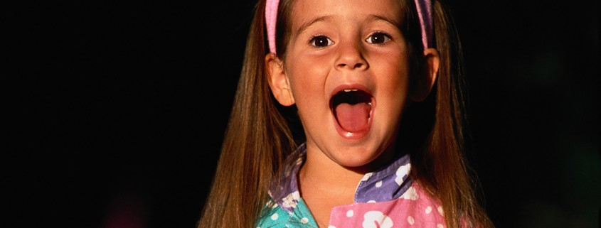 young girl singing loudly