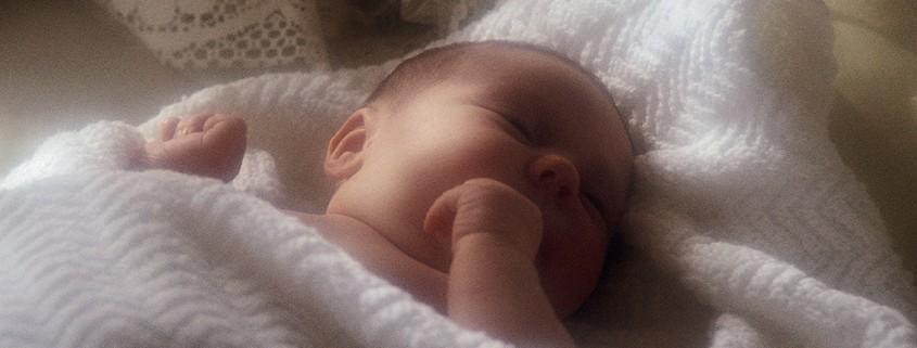 infant in blanket
