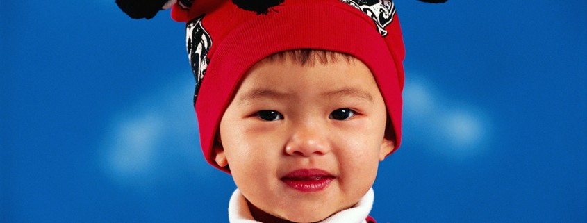 younf boy with funny knit hat