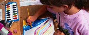 young girl paints