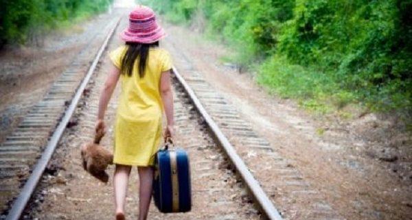 runaway girl on railroad tracks